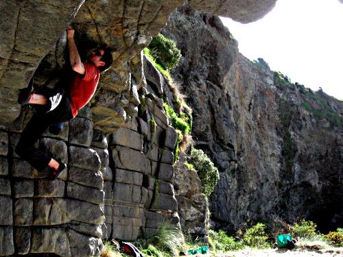 Cave bouldering on Long Beach, Dunedin