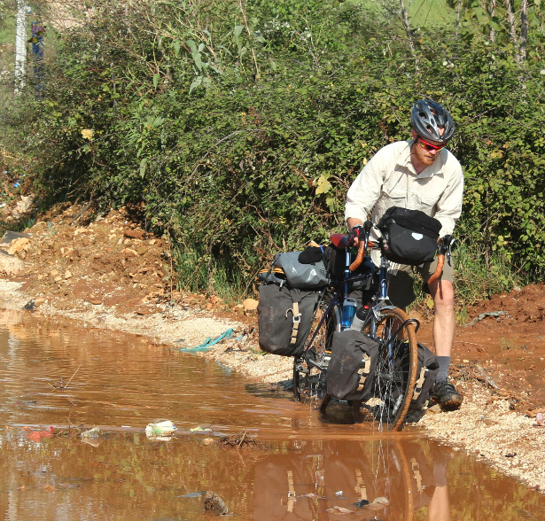 Cycling through Albanian mud