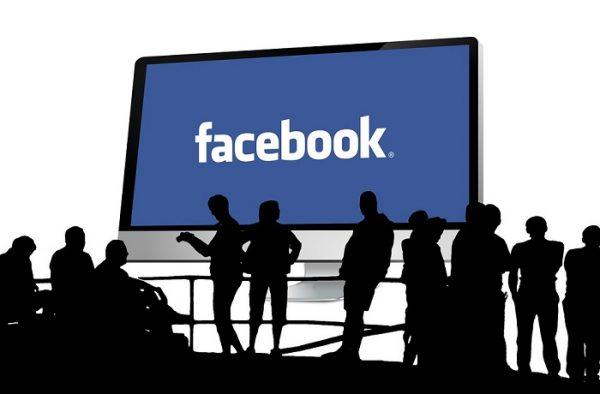 Facebook logo on a TV screen