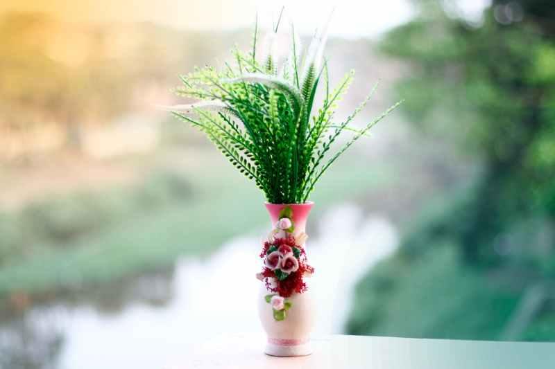 green and white plant on white ceramic vase