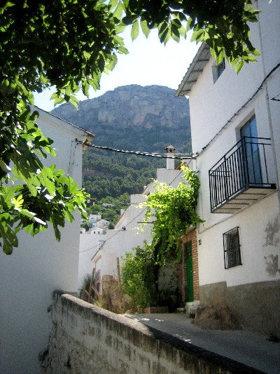 The streets of the town are narrow and steep, but people still drive cars through them.