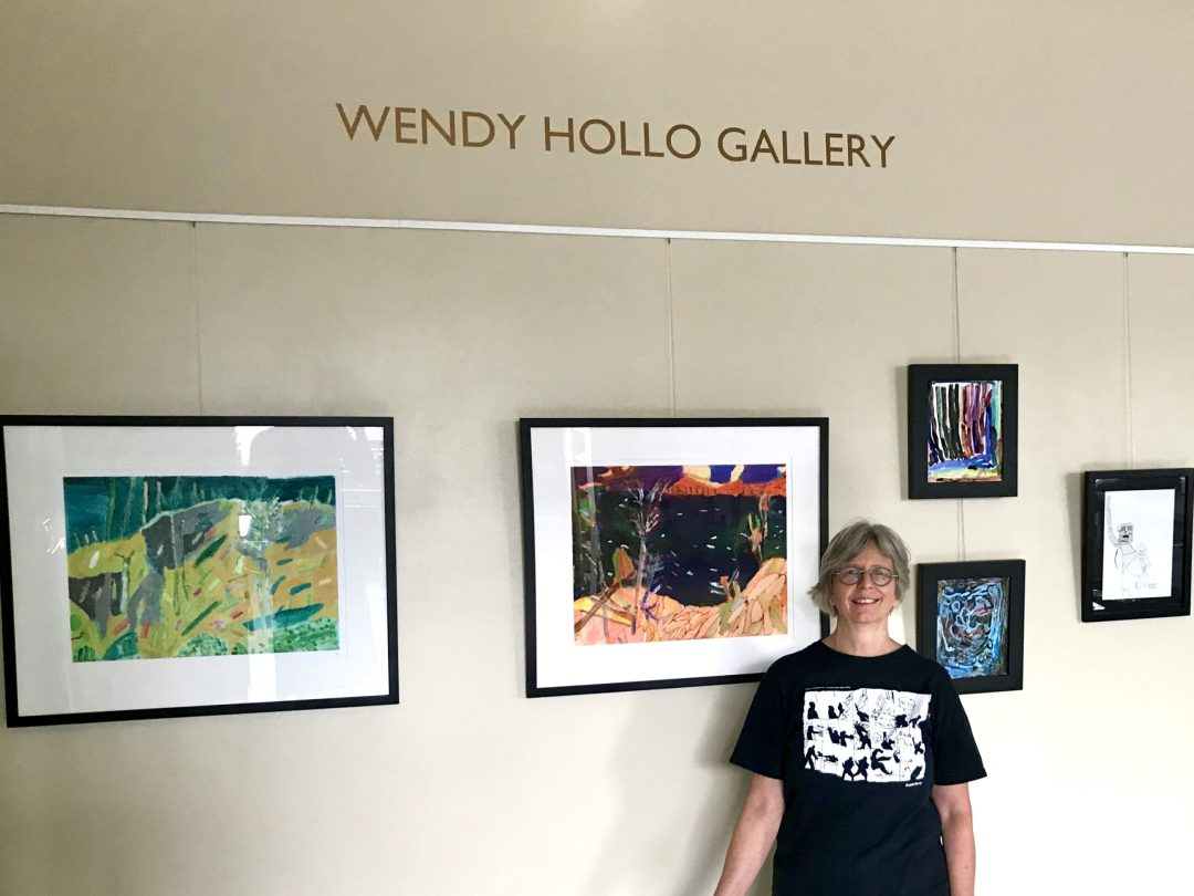 """Wendy in front of the newly named """"Wendy Hollo Gallery"""""""