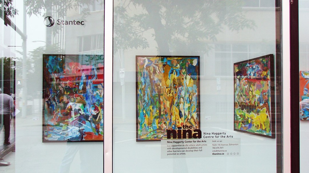 Paintings by Lora Pallister in a window display in City Centre Mall