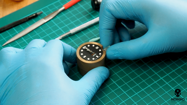 Image of hands installation from the Youtube video: Seiko Modding Tutorial: How to Install a Bezel & Bezel Insert (Using Seiko SKX007 in Vid)