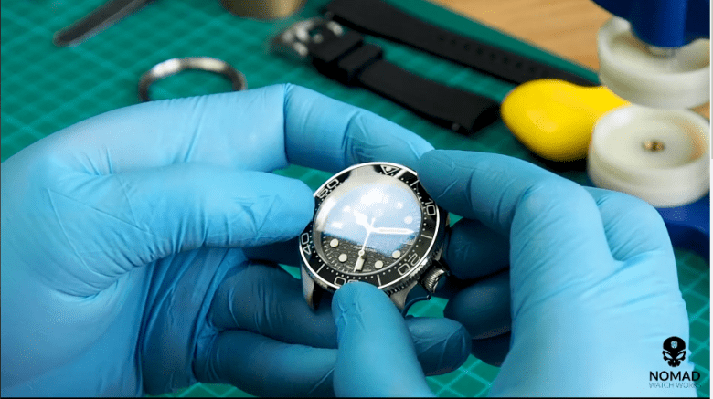 Image of a bezel insert installation from the Youtube: Seiko Modding Tutorial: How to Install a Bezel & Bezel Insert (Using Seiko SKX007 in Vid)