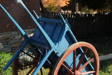 So much depends on a blue wheelbarrow with red wheels.