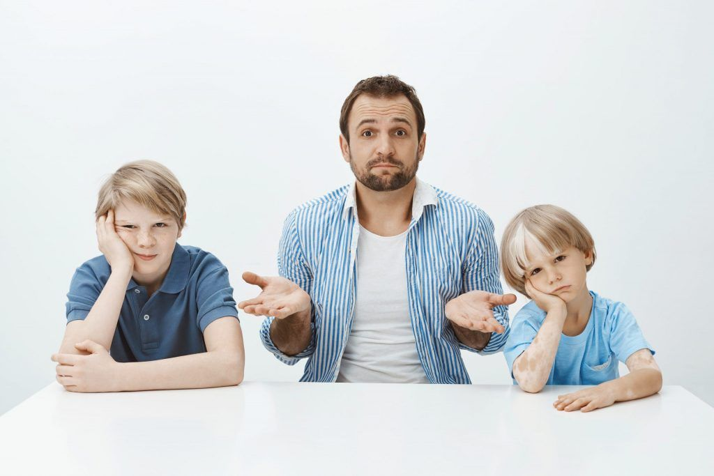 confused looking dad with children