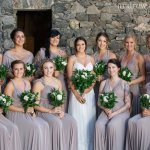Wedding Party in Courtyard by Stone Wall