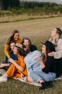 laughing friends having fun on picnic