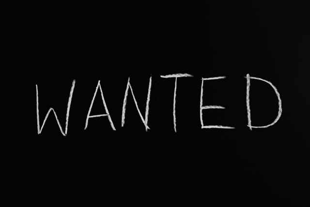 wanted lettering text on black background