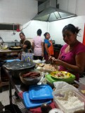 Busy, efficient staff in the kitchen! GOOD