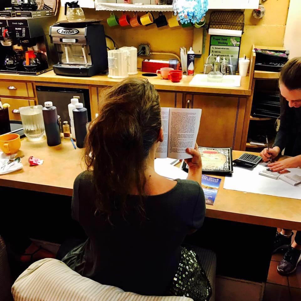 The Novel Tourist reading at cafe