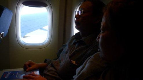 Mom and Dad on our flight