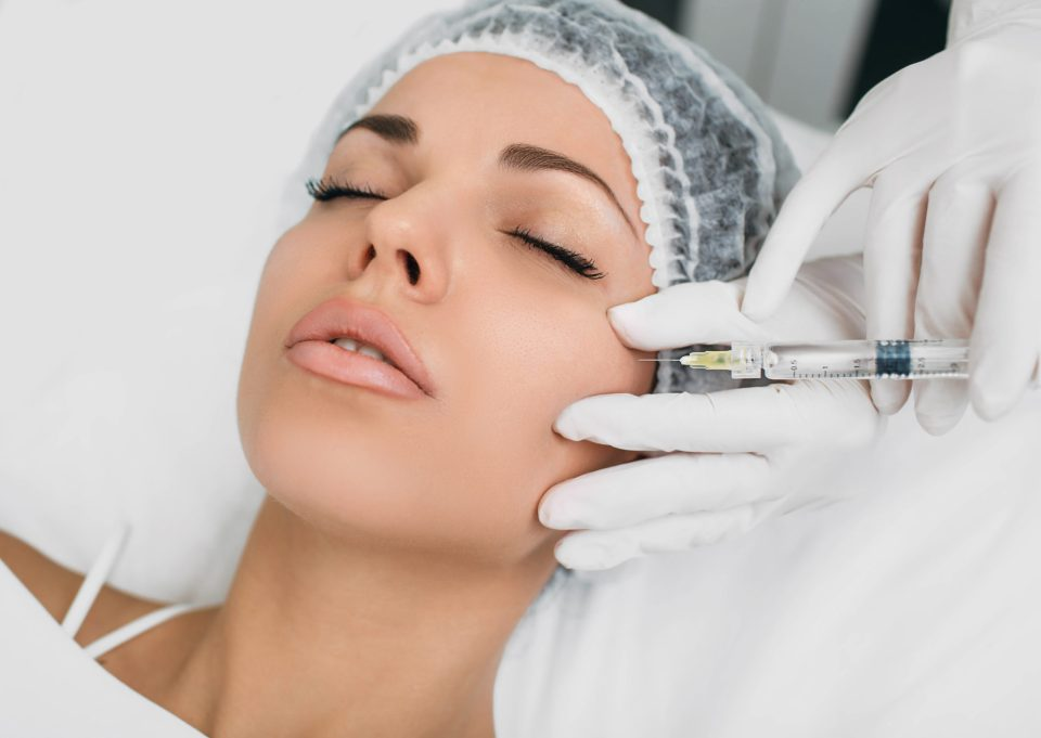 Woman getting profhilo injection in face