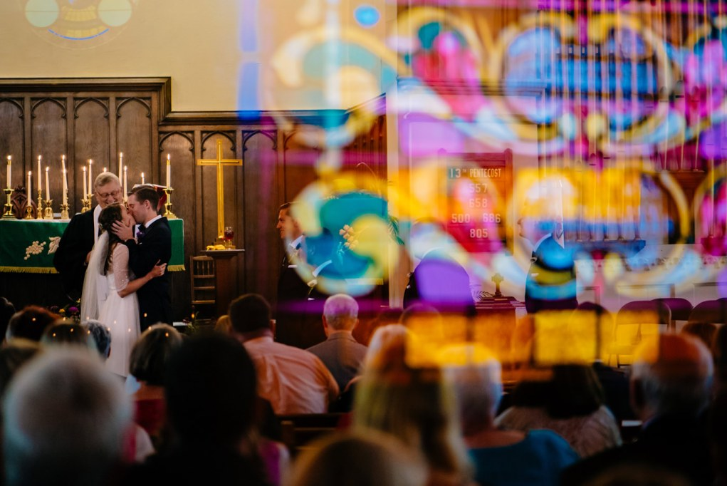 best wv wedding photography first kiss stained glass