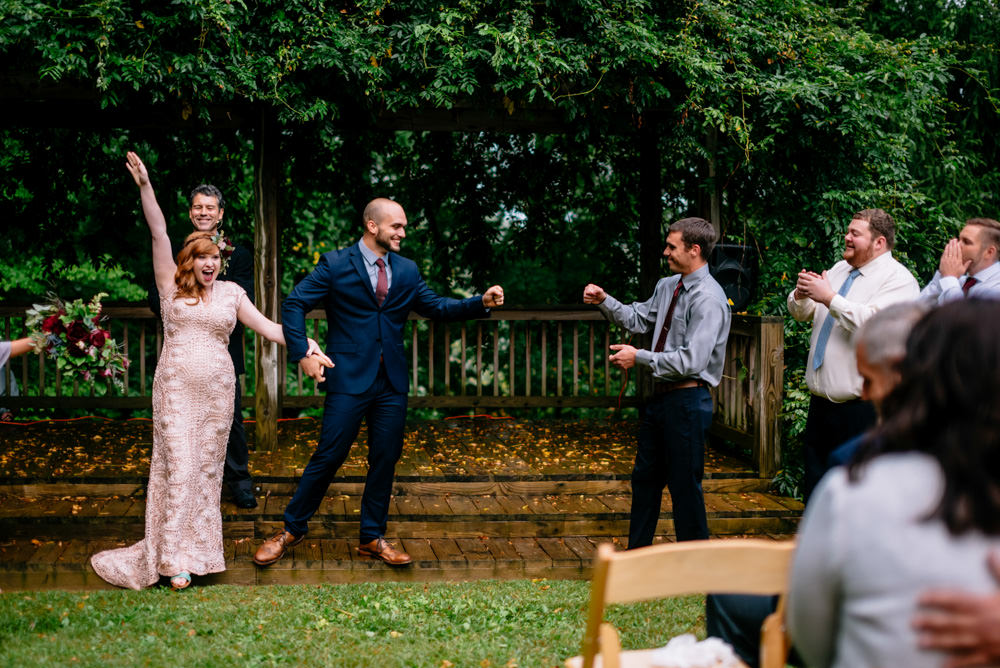 groom fist bump