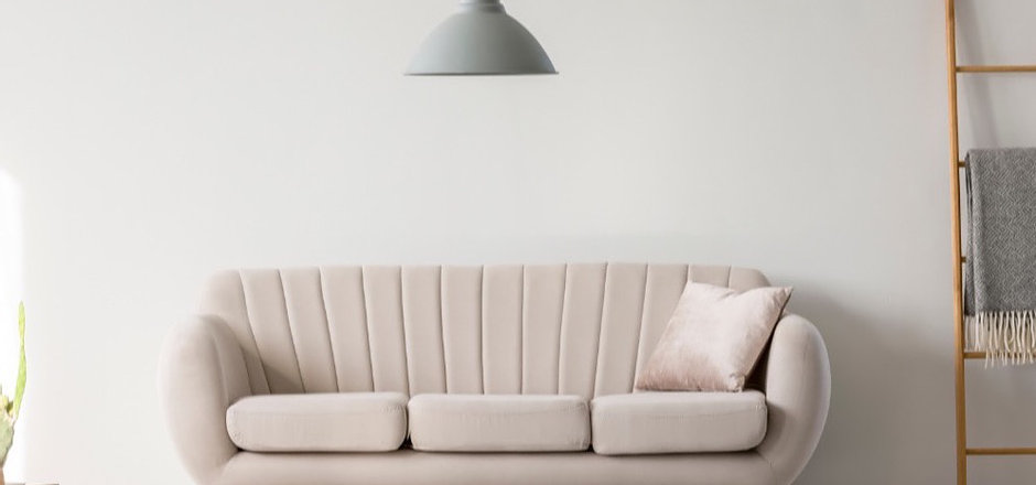 A tan couch with a crushed velvet pillow: a place to sit during OCD and Anxiety Treatment with Lauren Rosen, LMFT.