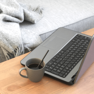 Cozy couch and computer: all you need for teletherapy and what your therapy with Lauren could look like.