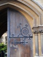 Beautiful swirly door hinge, and a peek into the garden