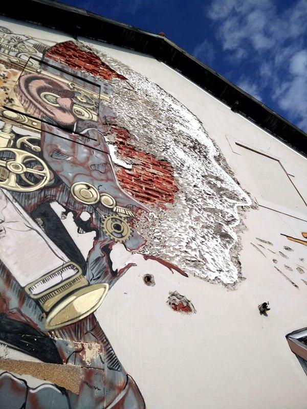 Portugal - Lisbon Street Art Vhils-Pixelpancho man-boat closeup