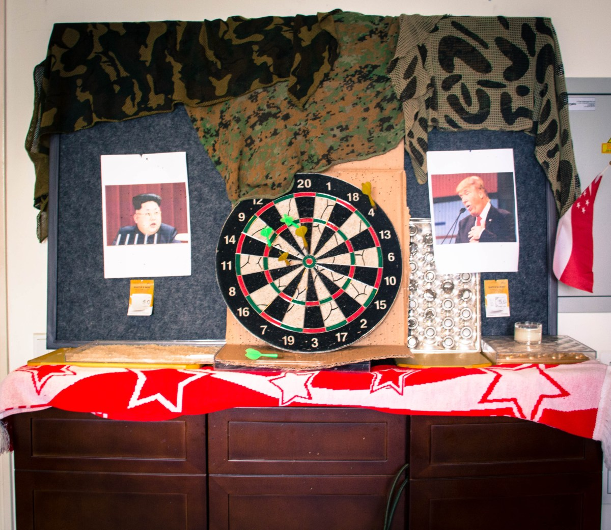 The suite's dartboard is adorned with pictures of Donald Trump and Kim Jong Un.