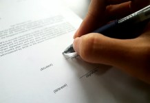 A student signs up to the Tuition Grant Scheme, restricting the post-graduation employment to Singapore for three years.