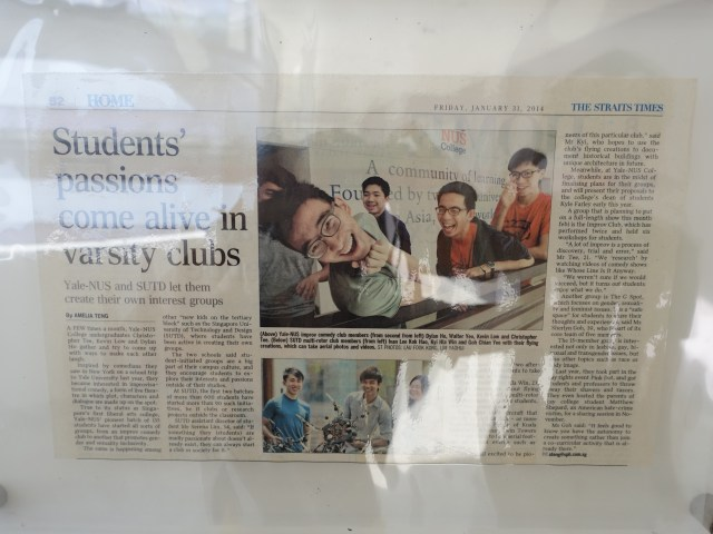 "Newsprint framed in SUTD, titled: ""Students' passions come alive in varsity clubs: Yale-NUS and SUTD let them create their own interest groups."" Print features photos of Yale-NUS students."