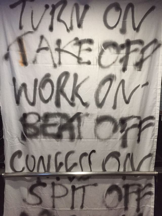 The sheets with spray painted messages were draped in lifts, immediately greeting anyone who walks in.