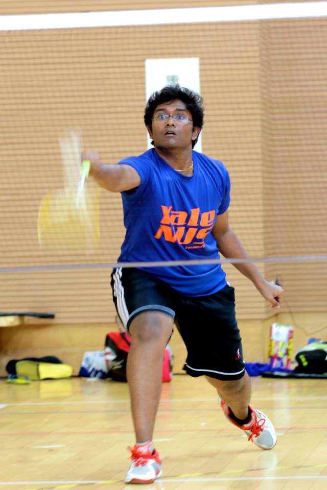 Tinesh Indrarajah playing badminton for Yale-NUS College.