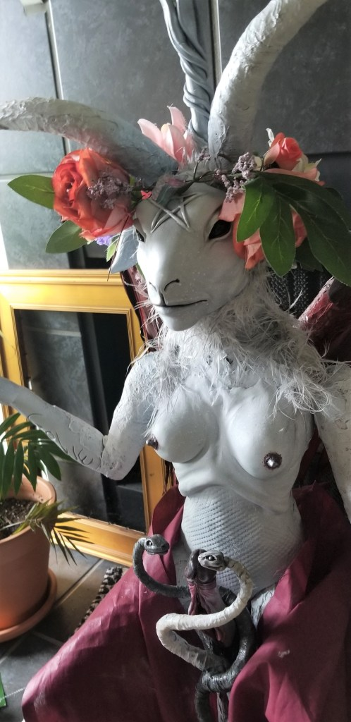 demon wearing flower crown