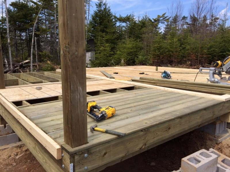 Cabin front deck pressure treated decking install