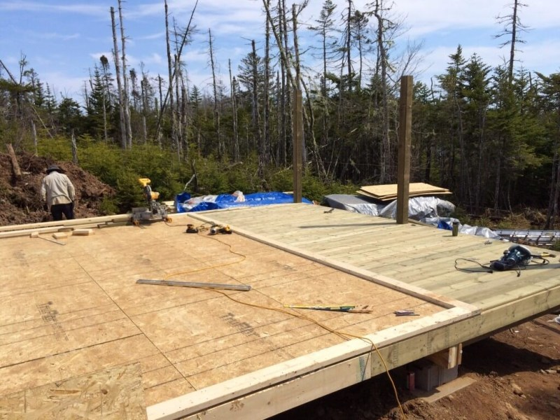 Cabin front deck pressure treated decking install complete