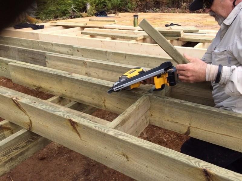 Cabin front deck subfloor framing cross bracing