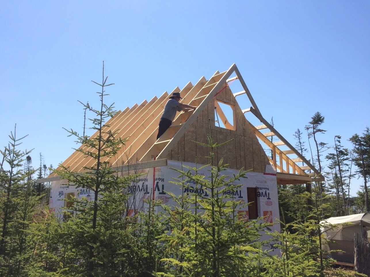 The ultimate roof and rafter guide for cabins tiny homes for Off grid cabin foundation