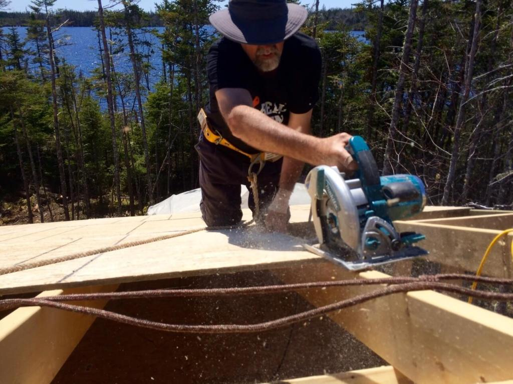 The-Off-Grid-Cabin-Roof-OSB-Sheathing-Cutting