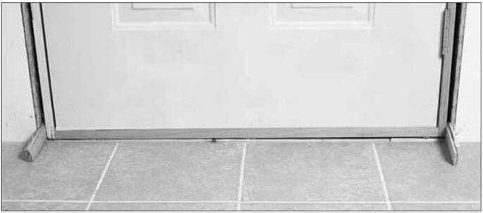 6 Door_Installation_Shim_bottom_of_door