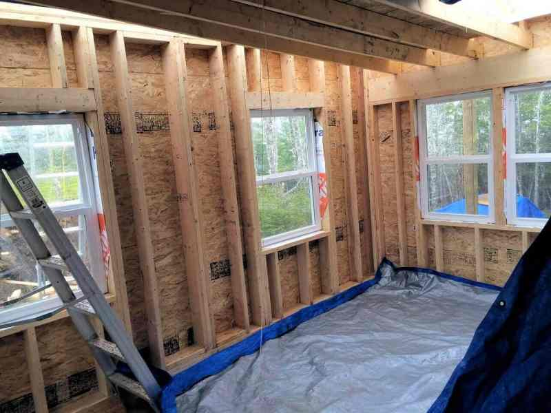 The-Off-Grid-Cabin-Living Room-and-Bedroom-windows-installed-inside