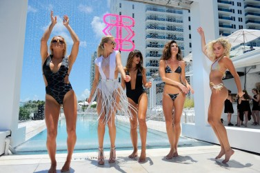 MIAMI BEACH, FL - JULY 16: Models dance in front of the runway at the Revel Rey 2017 Collection at SwimMiami - Runway at W South Beach on July 16, 2016 in Miami Beach, Florida. (Photo by Sergi Alexander/Getty Images for Revel Rey)