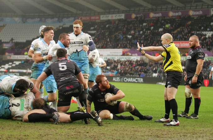 Referee Peter Fitzgibbon goes to the TMO before awarding Gordon Reid of Glasgow Warriors a try versus the Ospreys in January 2016.