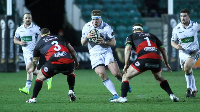 Alex Allen of Glasgow Warriors takes on Lloyd Fairbrother and Sam Hobbs of Dragons