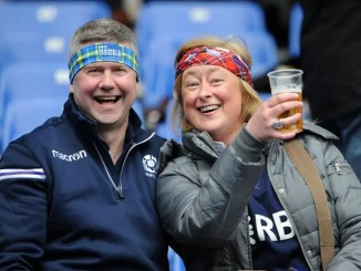 Scotland fans enjoying a pint of lager ***Image: ©Fotosport/Diego Forti***