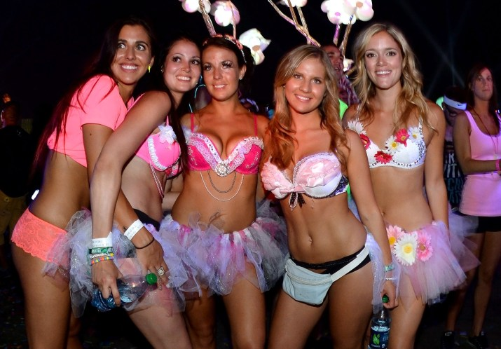 LAS VEGAS, NV - JUNE 23: (L-R) Kassandra Turner, Danika Main, Cassie Zimmerman, Katie Herda and Chrissy Lawton, all from Canada, watch a performance by DJs AN21 and Max Vangeli at the 17th annual Electric Daisy Carnival at Las Vegas Motor Speedway on June 23, 2013 in Las Vegas, Nevada. (Photo by Ethan Miller/Getty Images)