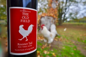 A bottle of wine wth a rooster in the background