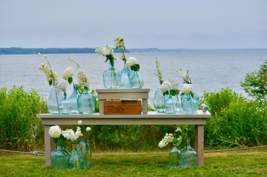 flowers placed in large blue jugs overlooking the bay