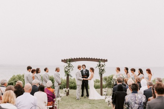 Ceremony in front of bay.