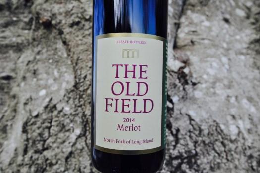 A bottle 0f 2014 Merlot wine.