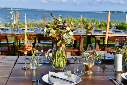 Table set up over looking the water.