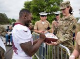 Spc. Christiana Howard, a human resources specialist with the 3d U.S. Infantry Regiment (The Old Guard) gets the autograph of a Washington Redskins player during the Salute to Service Day, at the Inova Sports Performance Center at Redskins Park on May 24, 2017 in Ashburn, Virginia. During the event, service members were given exclusive access to the training facility and observed the team during a private practice session. (U.S. Army photos by Sgt. Nicholas T. Holmes)