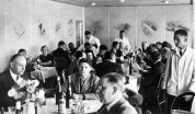 Dining on the Hindenburg - LZ 129 Hindenburg (Luftschiff Zeppelin #129; Registration: D-LZ 129) was a large German commercial passenger-carrying rigid airship, the lead ship of the Hindenburg class, the longest class of flying machine and the largest airship by envelope volume