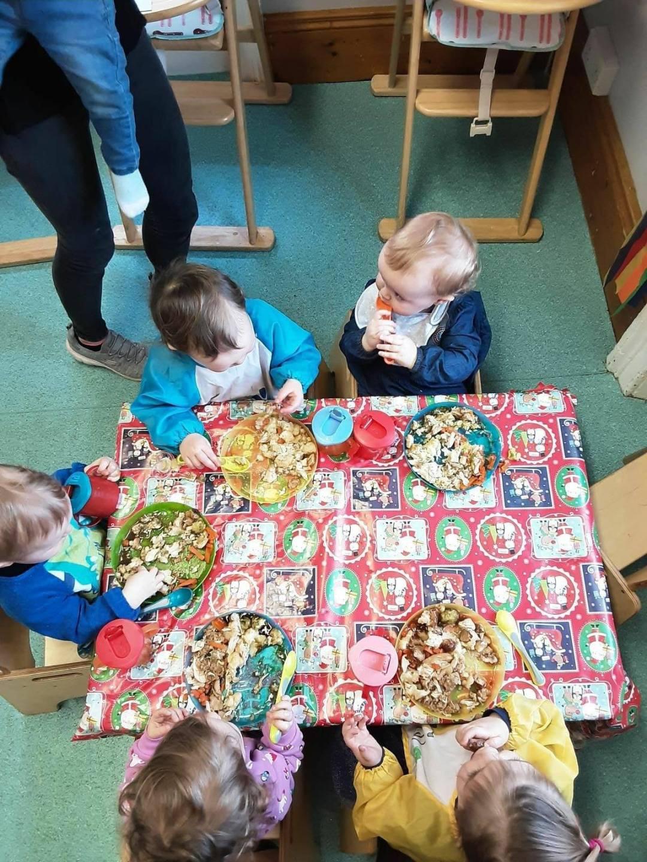 Children around a table eating Christmas dinner
